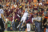 Landover, MD - September 3, 2017: West Virginia Mountaineers wide receiver David Sills V (13) tries to catch the ball between Virginia Tech Hokies defenders during game between Virginia Tech and WVA at  FedEx Field in Landover, MD.  (Photo by Elliott Brown/Media Images International)