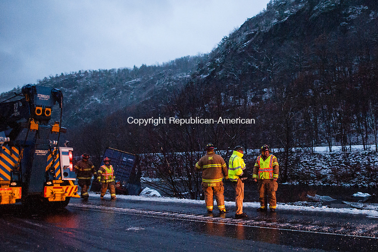 BEACON FALLS, CT-26 November 2014-112614EC05-  Emergency crews tend to a tractor trailer which overturned and slide down the embankment of the Naugatuck River Wednesday. It happened during the afternoon commute along Route 8 south, between exits 24 and 35 in Beacon Falls. Erin Covey Republican-American