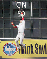 Philadelphia Phillies OF Gregg Dobbs reaches for a Carlos Lee double on Thursday May 22nd at Minute Maid Park in Houston, Texas. Photo by Andrew Woolley / Four Seam Images.