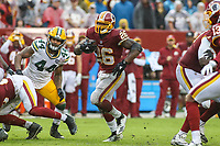 Landover, MD - September 23, 2018: Washington Redskins running back Adrian Peterson (26) runs for a first down during the  game between Green Bay Packers and Washington Redskins at FedEx Field in Landover, MD.   (Photo by Elliott Brown/Media Images International)