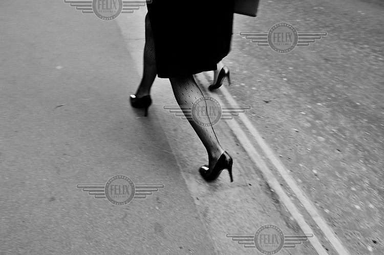 Women wearing high heeled shoes walking through the City of London. /Felix Features