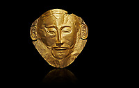 Mycenaean gold death mask, Mask of Agamemnon, Grave Cicle A, Mycenae, Greece.National Archaeological Museum of Athens.  Black Background<br /> <br /> The mask from Grave V depicts an imposing face of a bearded man descovered by  Heinrich Schliemann who believed it was the body of Agamemnon, this is unproven to date.  The Mycenaean death mask belonged to a warrior and made of gold leaf it cocered the dead mans face held on by cord threaded tgrough the two sides of the mask.  The mask of Agamemnon was created from a single thick gold sheet, heated and hammered against a wooden background with the details chased on later with a sharp tool. The artifact dates from the 16th century BC.