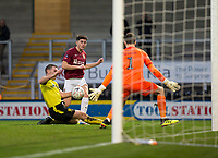 5th January 2020; Pirelli Stadium, Burton Upon Trent, Staffordshire, England; English FA Cup Football, Burton Albion versus Northampton Town; Scott Pollock of Northampton Town  takes a shot past Jake Buxton of Burton Albion and Goalkeeper Kieran O'Hara but the ball goes wide - Strictly Editorial Use Only. No use with unauthorized audio, video, data, fixture lists, club/league logos or 'live' services. Online in-match use limited to 120 images, no video emulation. No use in betting, games or single club/league/player publications