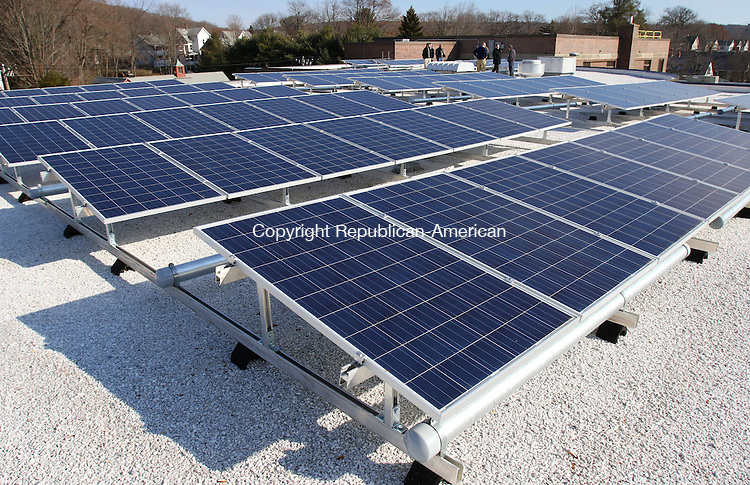 TORRINGTON CT. 24 November 2015-112415SV06-Officials tour the solar panels on the roof at Forbes School in Torrington Tuesday. The school was the first in the city to have solar panels installed on its roof and one on its wall to generate clean energy and reduce utility expenses. <br /> Steven Valenti Republican-American