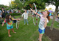 NWA Democrat-Gazette/BEN GOFF &bull; @NWABENGOFF<br /> Jaden Malonson, 8, (from left) Samantha Blackburn and Camille Bankston, 11, all of Bentonville play with hula hoops on Friday Aug. 7, 2015 during the Back to School Celebration First Friday on the Bentonville square.