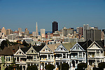 California, San Francisco: Alamo Square Victorians juxtaposed against the downtown San Francisco skyline..Photo #: 20-casanf79074.Photo © Lee Foster 2008