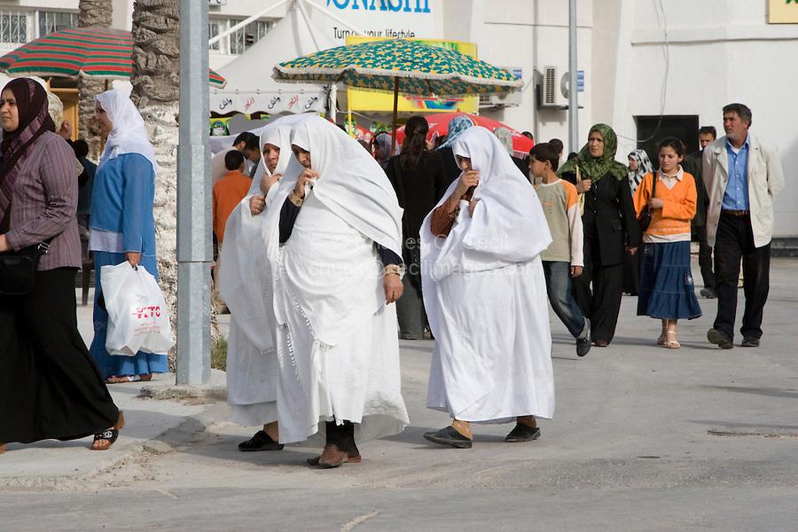 Tripoli, Libya, North Africa - Older Libyan Women wearing Traditional Furashiyas, a Light, White Outer Garment.