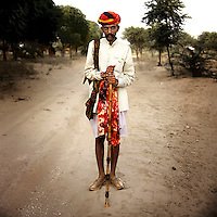 Emman Raika on the path to the Pushkar Camel Fair. Emman is an employee of Bhawerlal Raika, in charge of herding Bhawerlal's 40 camels the 150 km to Pushkar. The Raika are an ancestral caste of camel breeders in Rajasthan. Due to the increased cost of feeding and shelter, more and more Raika are being forced to sell off their camels, often for camel meat, which was once considered taboo.