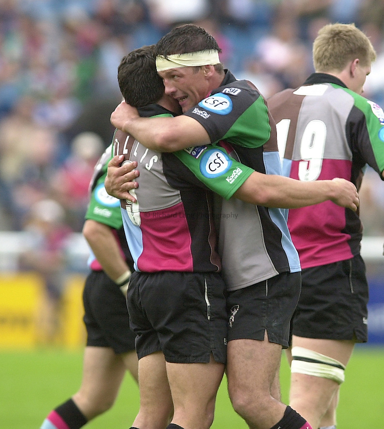 Photo:  Peter Spurrier..London Irish v NEC Harlequins. Zurich Premiership Rugby. 11/10/2003..Andre Vos hugs Ben Willis...