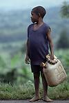 Boy carrying water container near Lake Kivu, Western Rwanda.