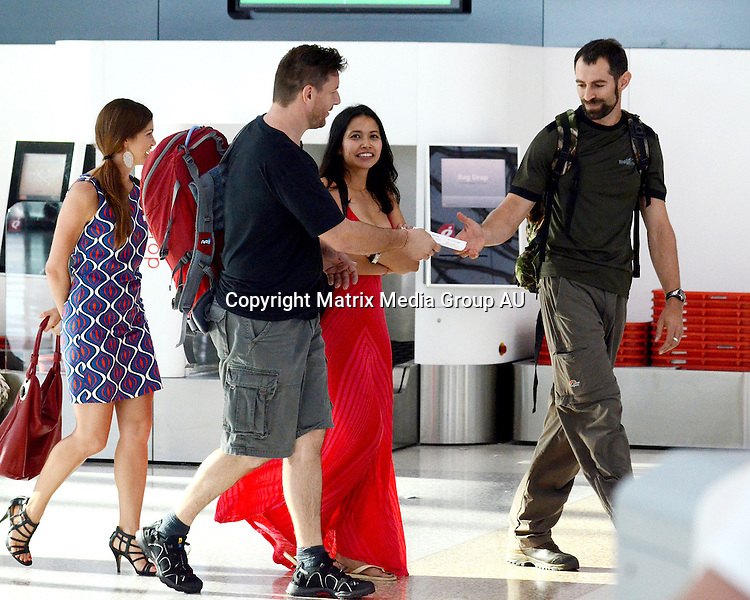 24 MARCH 2013 SYDNEY AUSTRALIA..EXCLUSIVE PICTURES..Manu Feildel pictured at Sydney Airport with his travel mate and his girlfriend Clarissa Weerasena checking in for his charity trip to Papau New Guinea to walk the Kokoda Trail. Manu and Clarissa looked very much in love as they put on a very big Public Display of Affection in the departure hall.
