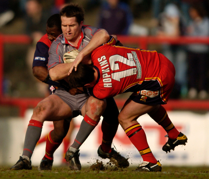 Photo: Richard Lane..London Broncos v Widnes Vikings. Engage Super League. 20/03/2005..Daniel Frame is tackled by Lee Hopkins.