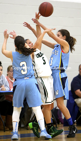 MIDDLEBURY CT. 16 January 2015-011616SV15-#5 Morgan Maisto of Chase Collegiate School tries to pass the ball as #3 Zulie Dunn and #21 Zola Bernardi of Westover School defend during basketball action in Middlebury Saturday. <br /> Steven Valenti Republican-American