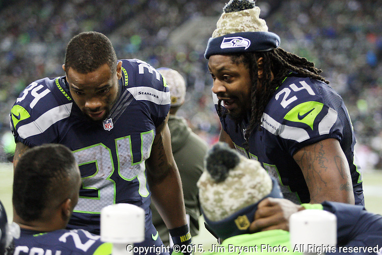 Seattle Seahawks running back Marshawn Lynch (24) talks to fellow running backs, Thomas Rawls (340 and Fred Jackson during their game against the Arizona Cardinals at CenturyLink Field in Seattle, Washington on November 15, 2015. The Cardinals beat the Seahawks 39-32.   ©2015. Jim Bryant photo. All Rights Reserved.