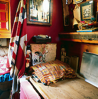 The cosy interior of a canal boat decorated in a bohemian style. A corner of the sleeping area