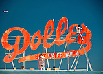 Workers repaint and overhaul the Dolles sign in the spring.  The landmark sign above Dolles Salt Water Taffy is a landmark at the intersection between the beach boardwalk and the end of Rehoboth Avenue in Rehoboth Beach, Delaware, USA.