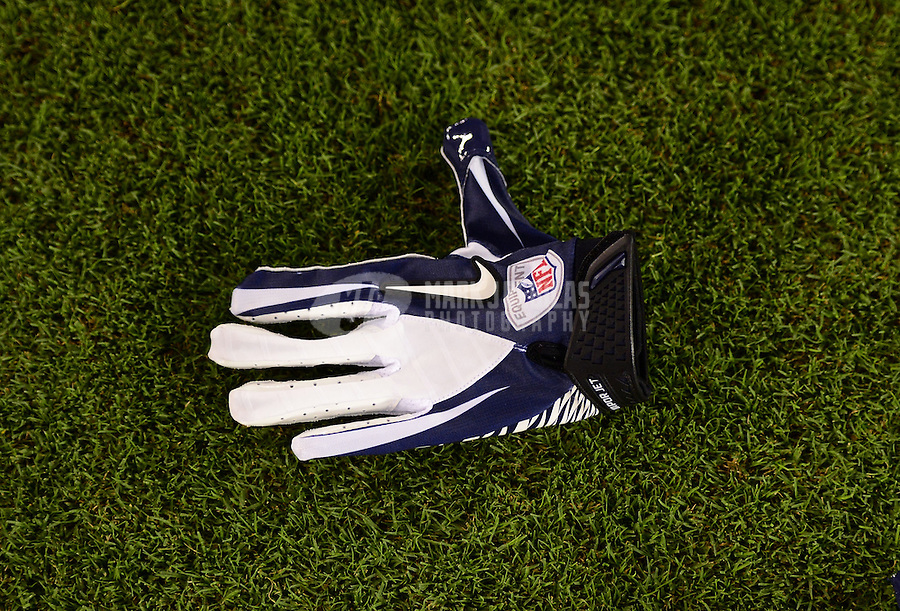 Aug. 30, 2012; Glendale, AZ, USA; Detailed view of a Nike glove on the field during the game between the Denver Broncos against the Arizona Cardinals during a preseason game at University of Phoenix Stadium. Mandatory Credit: Mark J. Rebilas-