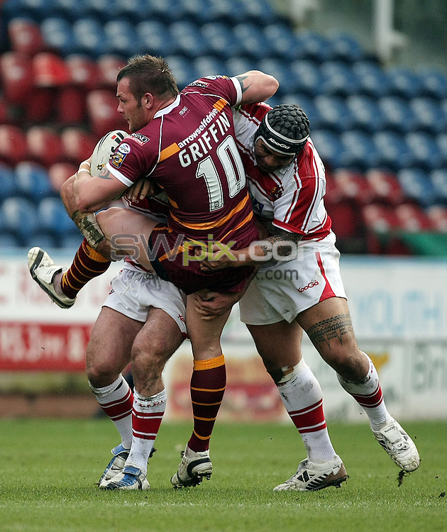 PICTURE BY VAUGHN RIDLEY/SWPIX.COM - Rugby League - Preseason Friendly - Huddersfield Giants v Wigan Warriors - Galpharm Stadium, Huddersfield, England - 25/01/09...Copyright - Simon Wilkinson - 07811267706...Huddersfield's Darrell Griffin is tackled by Wigan's Phil Bailey and Iafeta Paleaaesina.