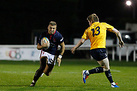 Luke Hibberd of London Scottish runs at the Yorkshire Carnegie defence during the Championship Cup match between London Scottish Football Club and Yorkshire Carnegie at Richmond Athletic Ground, Richmond, United Kingdom on 4 October 2019. Photo by Carlton Myrie / PRiME Media Images