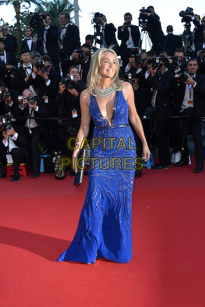 Sharon Stone.'Cleopatra' premiere at the 66th  Cannes Film Festival, France..21st May 2013.full length blue lace dress plunging neckline cleavage  silver necklace clutch bag  .CAP/PL.©Phil Loftus/Capital Pictures.