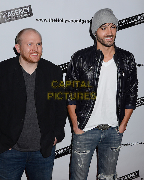"guest & Jeremiah James, From Joyce.The Hollywood Agency presents a private after party for People's Choice Awards 2012 hosted by Mario Lopez of NBC's ""Extra"" held at Conga Room L.A. Live, Los Angeles, California, USA..January 11th, 2012.half length black jacket leather white top hat beanie facial hair beard.CAP/ADM/BT.©Birdie Thompson/AdMedia/Capital Pictures."