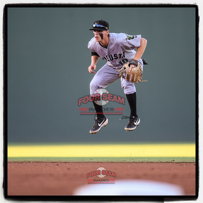 Simon Whiteman (10) of the Augusta GreenJackets hops into the air as a pitch is thrown in a game against the Greenville Drive on Thursday, August 29, 2019, at Fluor Field at the West End in Greenville, South Carolina. Augusta won, 11-0. (Tom Priddy/Four Seam Images) #MiLB