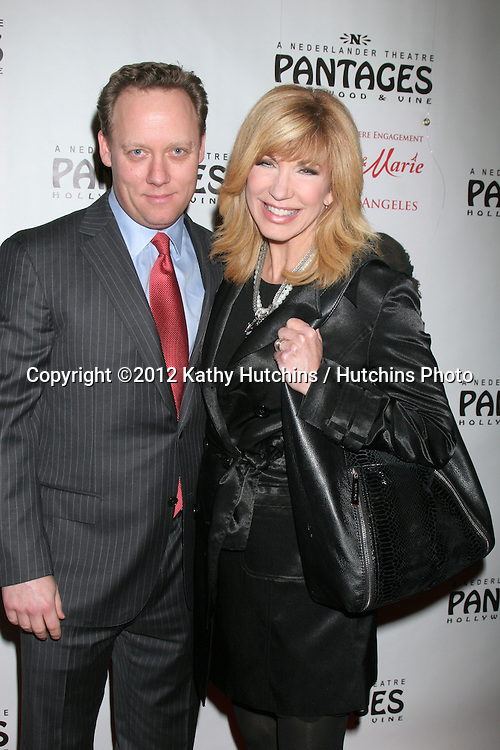 "LOS ANGELES - DEC 4:  Leeza Gibbons and husband arrives to ""Donny & Marie - Christmas in Los Angeles"" Opening Night at Pantages Theater on December 4, 2012 in Los Angeles, CA"
