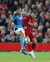 27th November 2019; Anfield, Liverpool, Merseyside, England; UEFA Champions League Football, Liverpool versus SSC Napoli ; Allan of SSC Napoli competes for the ball with Roberto Firmino of Liverpool - Editorial Use