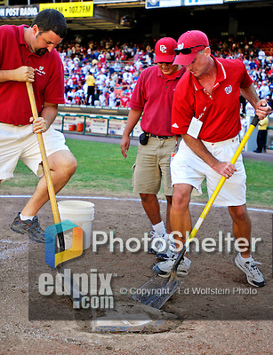 23 September 2007: Washington Nationals Grounds Crew (right) dig up the home plate preparing for a post-game ceremony commemorating the last professional baseball game played at Robert F. Kennedy Memorial Stadium in Washington, DC. The Nationals defeated the visiting Philadelphia Phillies 5-3 to close out the 2007 season at RFK Stadium.. .Mandatory Photo Credit: Ed Wolfstein Photo