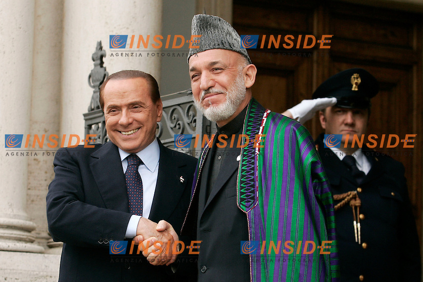 SILVIO BERLUSCONI E AHAMID KARZAI.Roma 02/05/2011 Il Presidente del Consiglio Silvio Berlusconi incontra a Villa Pamphilj il Presidente della Repubblica islamica dellÍAfghanistan, Hamid Karzai..Italian Premier silvio Berlusconi meets the President of Republic islamic of Afghanistan, Hamid Karzai..Photo Samantha Zucchi Insidefoto