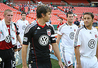 Carey Talley #8 of D.C. United and Richard Hughes #22 of Portsmouth FC during an international friendly match at RFK Stadium on July 24 2010, in Washington D.C.United won 4-0.
