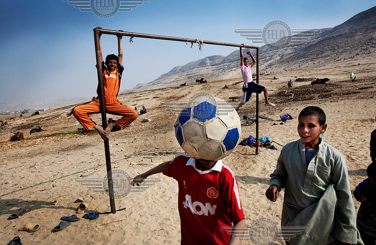 Children playing football near the tombs of Beni Hasan..