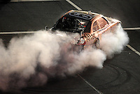 Oct. 17, 2009; Concord, NC, USA; NASCAR Sprint Cup Series driver Carl Edwards heads into the garage after blowing an engine during the NASCAR Banking 500 at Lowes Motor Speedway. Mandatory Credit: Mark J. Rebilas-