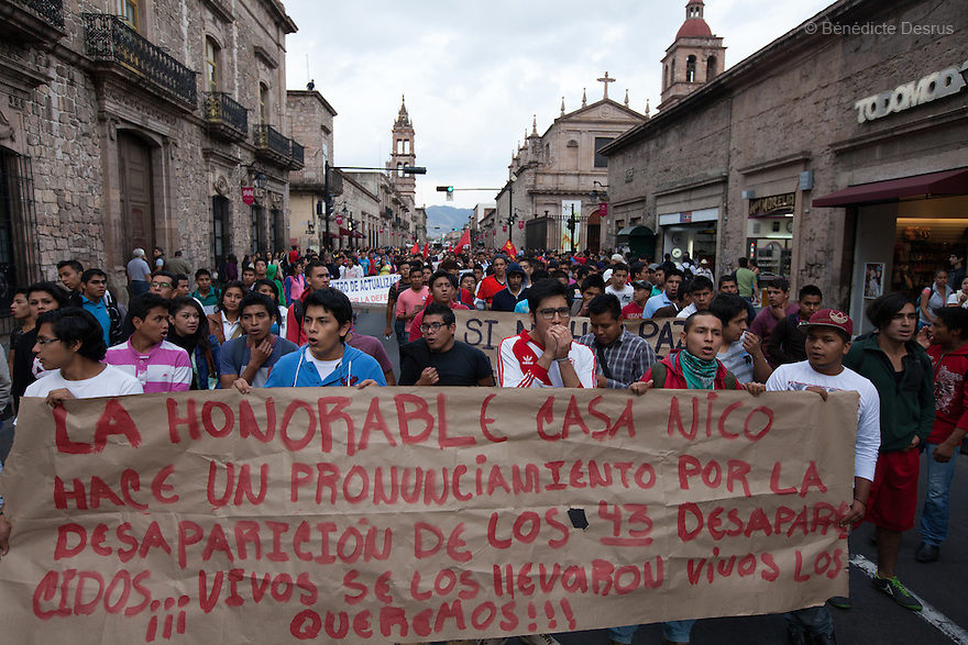 Demonstrators march to demande justice for the disappearance of 43 students from Ayotzinapa's teacher training college in Morelia, Michoacan, Mexico on November 19, 2014. The relatives of the 43 missing students still do not believe the official line that the young men are all dead, and with classmates, social organizations and human rights defenders, they started on Thursday a national caravan. They split up into three different caravans, branching out to share information face to face with supporters in other cities and rally nationwide support. The three groups will meet in Mexico City on Thursday 20 for a general strike and massive marches to demand justice and fight against corrupted government and organized crime. Criticism of the government has intensified in Mexico, and many are demanding that the search for the 43 missing students continue until there is concrete evidence to the contrary. (Photo by BénédicteDesrus)