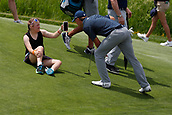 ERIN, WI - JUNE 14: Ellie Spieth the sister of PGA golfer Jordan Spieth shows Jordan something on her phone while on the 13th hole during the practice round for the 117th US Open on June 14, 2017 at Erin Hills in Erin, Wisconsin