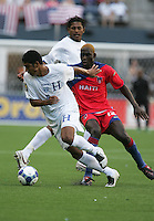 Melvin Valladares (18) dribbles against James Marcelin (12). Honduras defeated Haiti 1-0 during the First Round of the 2009 CONCACAF Gold Cup at Qwest Field in Seattle, Washington on July 4, 2009.