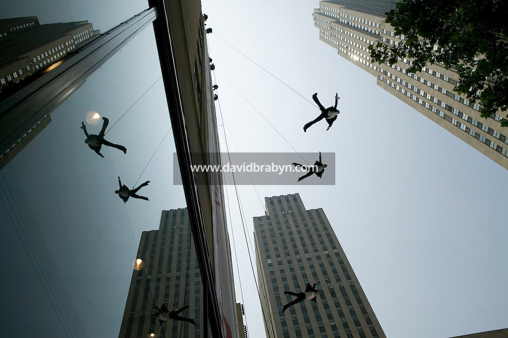 27 July 2005 - New York, USA - Dancing athletes rappel down the vertical side of a 9-story high building on Rockefeller Plaza in New York, USA, to launch Target's new fall 05 collection, 27 Juky 2005.