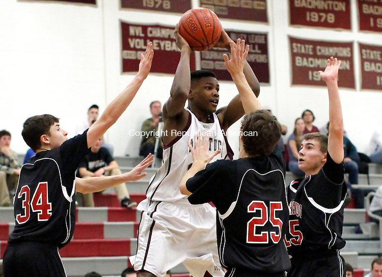 Naugatuck, CT-29 December 2011-122911CM09-  Naugatuck's Husani Foote tries to make a pass as he's swarmed by Pomperaug defenders, Nathan Rubinstein (34) Stephen Consiglio (25) and Carl Gatzendorfer (15) during their non-league match-up in Naugatuck Thursday night.  Pomperaug was too tough for Naugy winning, 67-57.   Christopher Massa Republican-American