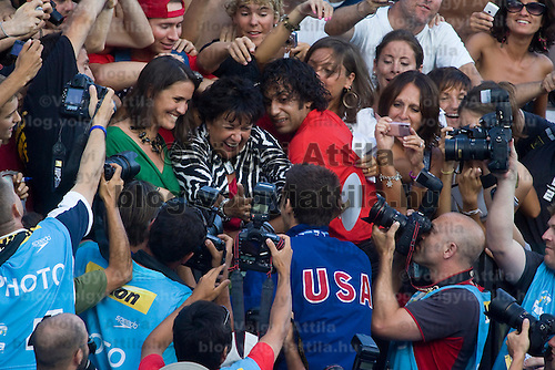 Michael Phelps (USA) together with his girlfriend and mother celebrates his victory in 100 Men's Butterfly swimming competition during the 13th FINA Swimming World Championships held in Rome, Italy. Friday, 31. July 2009. ATTILA VOLGYI