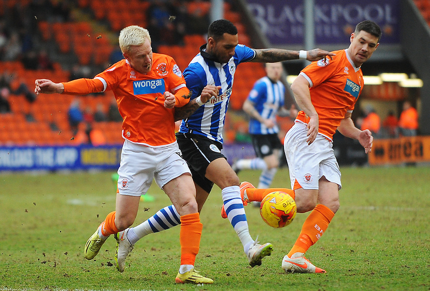 Blackpool's David Perkins vies for possession with Wigan Athletic's Jermaine Pennant<br /> <br /> Photographer Kevin Barnes/CameraSport<br /> <br /> Football - The Football League Sky Bet Championship - Blackpool v Wigan Athletic - Saturday 28th February 2015 - Bloomfield Road - Blackpool<br /> <br /> &copy; CameraSport - 43 Linden Ave. Countesthorpe. Leicester. England. LE8 5PG - Tel: +44 (0) 116 277 4147 - admin@camerasport.com - www.camerasport.com
