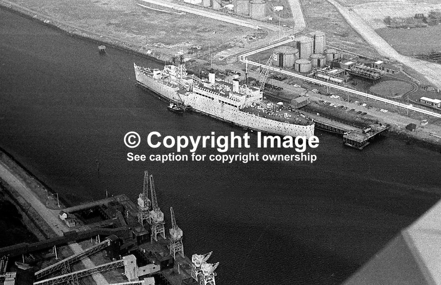 HMS Maidstone, moored in Belfast Harbour Estate, was initially sent to Belfast, N Ireland, to accommodate up to 2000 British soldiers. In August 1971 she was used to hold republican internees. 197109000346.<br />