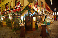 Traditional festive restaurant at night with christmas lights and decorations - Strasbourg, Alsace France