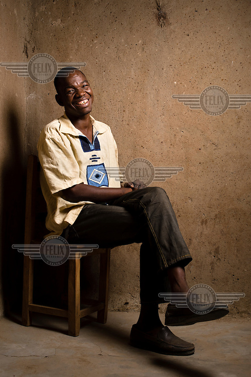 When Francis Pii Kugbila became mentally unwell in 2009, his brothers took him to a traditional healer who forced his leg through a hole in a heavy length of tree trunk and pinned it in place, fashioning a crude restraint. Kugbila spent two years restrained in this manner, naked in this bare concrete room near Bolgatanga in the Upper East region of Ghana, where he ate, slept and relieved himself. In late 2010 he came to the attention of mental health advocacy NGO, BasicNeeds, who arranged for him to receive appropriate treatment and negotiated for his release. Now fully recovered, pictured here on 28 January 2013, Kugbila has been able to rebuild his family life and return to his profession as a teacher.