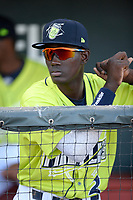 Shortstop Ronny Mauricio (2) of the Columbia Fireflies in the dugout before a game against the Delmarva Shorebirds on Thursday, May 2, 2019, at Segra Park in Columbia, South Carolina. Delmarva won, 1-0. (Tom Priddy/Four Seam Images)