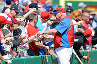 Philadelphia Phillies manager Charlie Manuel #41 signs autographs before a Spring Training game against the Dominican Republic at Bright House Field on March 5, 2013 in Clearwater, Florida.  The Dominican defeated Philadelphia 15-2.  (Mike Janes/Four Seam Images)