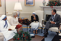 United States President George H.W. Bush, right, and first lady Barbara Bush, center left, meet with Mother Teresa, founder, Roman Catholic Missionaries of Charity, center right, in the Oval Office of the White House in Washington, D.C. on December 9, 1991.<br /> Mandatory Credit: Carol T. Powers / The White House via CNP /MediaPunch