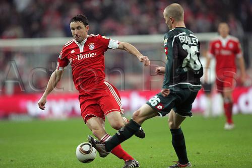 05/12/2009 Bundesliga Bayern v Borussia Moenchengladbach. Mark van Bommel and Michael Bradley Gladbach.
