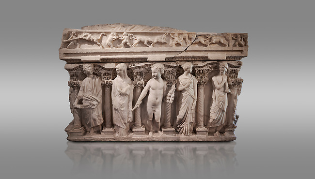 """Roman relief sculpted sarcophagus with kline couch lid, """"Columned Sarcophagi of Asia Minor"""" style typical of Sidamara, 3rd Century AD, Konya Archaeological Museum, Turkey. Against a grey background"""