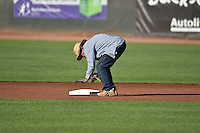 A member of the Ogden Raptors grounds crew readies the field prior to the game against the Great Falls Voyagers in Pioneer League action at Lindquist Field on July 16, 2014 in Ogden, Utah.  (Stephen Smith/Four Seam Images)