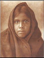 BNPS.co.uk (01202 558833)<br /> Pic: Bloomsbury/BNPS<br /> <br /> Qahatika Girl in 1907.<br /> <br /> Lost souls - Poignant archive reveals the lost tribes of North America in beautiful photographs from just over a century ago.<br /> <br /> A remarkable collection of photographs which give an unprecedented insight into the lives of Native Americans at a time when their land was being taken from them have emerged at auction.<br /> <br /> Between 1907 and 1930, US photographer Edward Curtis spent time with more than 80 native tribes across Native America, taking thousands of photographs as part of his groundbreaking The North American Indian project.<br /> <br /> A collection of more than 500 rare Curtis photographs are being auctioned off later this month and are expected to fetch over &pound;300,000.